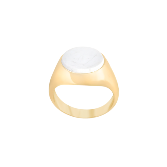 Image of Lana Oval Gold signet ring from NIOMO's Signet Collection with white gemstone called howlite, cut in oval shape. The ring is made of solid 925 sterling silver and plated in 18kt yellow gold. It's available in different sizes.