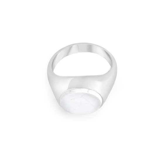 Image of Lana Oval Silver Signet Ring from NIOMO's Signet Collection with white gemstone called howlite, cut in oval shape. The ring is made of solid 925 sterling silver and available in different sizes.