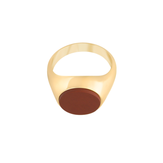 Image of Philomena Oval Gold signet ring from NIOMO's Signet Collection with red gemstone called jasper, cut in oval shape. The ring is made of solid 925 sterling silver and plated in 18kt yellow gold. It's available in different sizes.