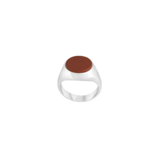 Image of Philomena Oval Silver signet ring from NIOMO's Signet Collection with red gemstone called jasper, cut in oval shape. The ring is made of solid 925 sterling silver and available in different sizes.